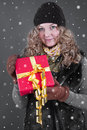 Woman in winter clothes with gift box for christmas portrait of blonde Royalty Free Stock Photos