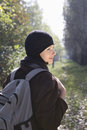 Woman in winter clothing with backpack at park rear view of a beautiful young Royalty Free Stock Photos