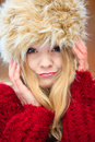 Woman in winter clothing fur cap autumn or fashion closeup happy young wearing fashionable wintertime clothes outdoor portrait Royalty Free Stock Photo