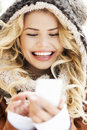 Woman in winter clothing texting young Royalty Free Stock Photos