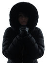 Woman winter coat freezing cold silhouette one in on white background Royalty Free Stock Image