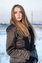 Woman in winter coat outdoors standing at the snow Royalty Free Stock Photos