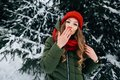 stock image of  Beautiful woman sends kiss in camera in winter snowy forest