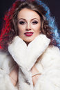 Woman in winter fur artistic lights Stock Photography