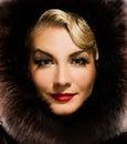 Woman in winter fur coat Stock Photo