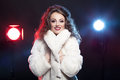 Woman in winter fur with two lights behind Royalty Free Stock Photo