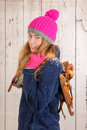 Woman in winter with old dutch wooden ice skates portrait of pink hat and Stock Photography