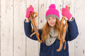 Woman in winter with old dutch wooden ice skates portrait of pink hat and Royalty Free Stock Photos