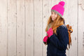 Woman in winter with old dutch wooden ice skates portrait of pink hat and and copy space Stock Photo