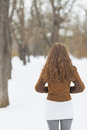 Woman in winter park rear view with long hair Royalty Free Stock Photos
