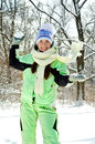 Woman in winter throwing snowball Royalty Free Stock Photo