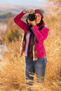 Woman winter wildness pretty taking photos of Stock Photography
