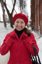 Woman in wintry clothes walking on the sidewalk Royalty Free Stock Photo