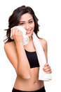 Woman wiping sweat with towel fitness a Royalty Free Stock Images