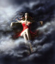 Woman witch  in clouds in  red dress Royalty Free Stock Photo