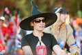 Woman In Witch Hat Walks In Halloween Parade Stock Photos