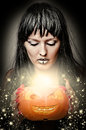 Woman witch making magic to pumpkin Royalty Free Stock Image
