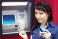 Woman withdrawing money from credit card at ATM Royalty Free Stock Photo