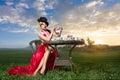 Woman at wonderland tea-party Royalty Free Stock Photo