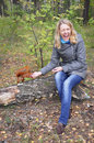 Woman in the woods squirrel bites the hand girl screams frightened her Royalty Free Stock Photo