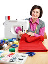 Woman worker sews sewing machine Royalty Free Stock Image