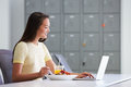 Woman Working In Design Studio Having Lunch At Desk Royalty Free Stock Photo