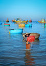 A woman working at fishing village in Cam Ranh bay, Vietnam Royalty Free Stock Photo