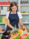 Woman working at grocery store beautiful young Royalty Free Stock Image