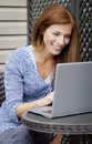 Woman working home on laptop outside the patio Stock Photography