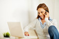 Woman working on laptop and on the phone Royalty Free Stock Photo