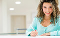 Woman working at the office beautiful and smiling Stock Image