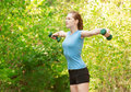 Woman working out with dumbbells Stock Photo