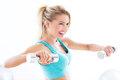 Woman working out with dumbbells in gym exercising Royalty Free Stock Photos
