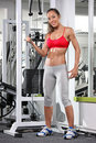 Woman working out on a fitness equipment Royalty Free Stock Image