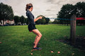 Woman working out with resistance band in the park Royalty Free Stock Photo