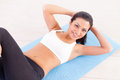 Woman working out top view of cheerful young indian training on yoga mat Royalty Free Stock Images
