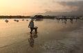 A woman working on salt field in Phan Rang, Vietnam Royalty Free Stock Photo