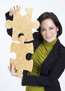 Woman Working With Two Large Jigsaw Puzzle Pieces Royalty Free Stock Images