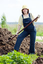 Woman works with animal manure at field Royalty Free Stock Photo