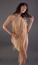 Woman wrapped in sparkly shawl an image of a pretty young wearing a gold as a dress Stock Image