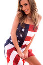 Woman wrapped in USA flag. Royalty Free Stock Photo