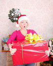 Woman wrapping christmas presents wearing santa ha Royalty Free Stock Images