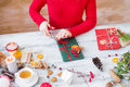 Woman wrapping gift a christmas Royalty Free Stock Image