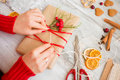 Woman wrapping gift on table Royalty Free Stock Photo