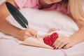 Woman writing love letter with feather pen Royalty Free Stock Photo
