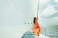 Woman yachting white sails luxury sailboat travel Royalty Free Stock Photo