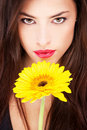 Woman and yellow daisy Stock Photo