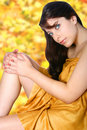 Woman in yellow day spa. Royalty Free Stock Images