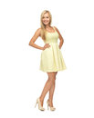 Woman in yellow dress picture of young on high heels Royalty Free Stock Images