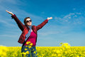 Woman in yellow field of rapeseed